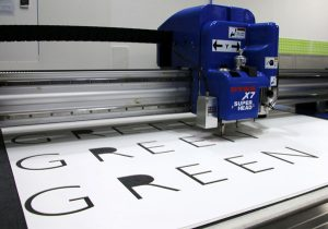 Foamex Signage Lettering being cut on a DYSS cutter. Designed in KASEMAKE.